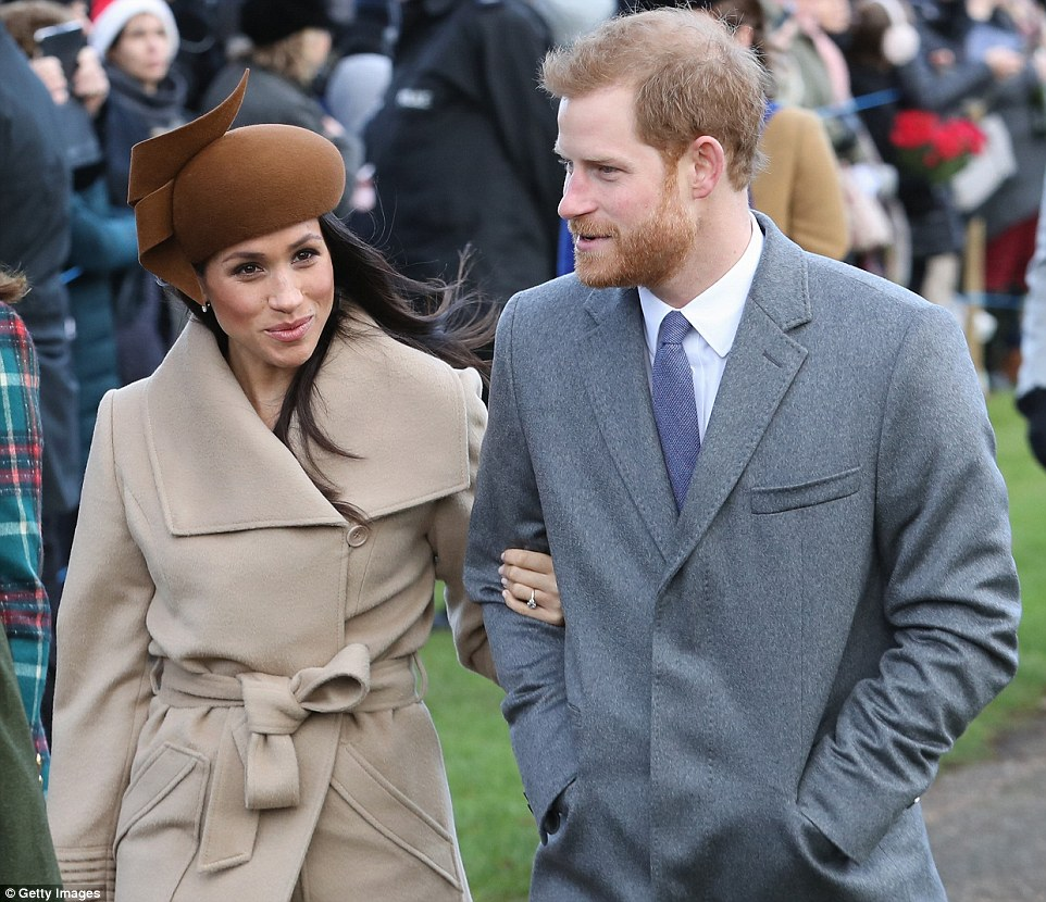 Meghan, 36, clutched on to her Royal beau and proudly displayed the engagement ring that Harry himself designed before their engagement in November Photo (C) GETTY