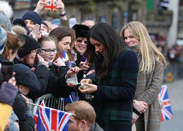 Meghan greets royal fans in Edinburgh Photo (C) PA