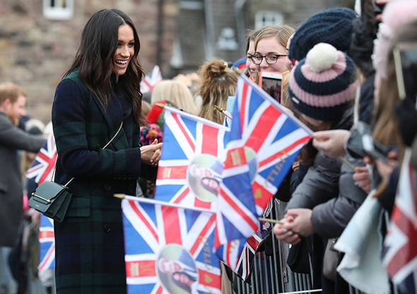 Meghan sent a message to her royal fans in Scotland as she donned tartan Photo (C) PA