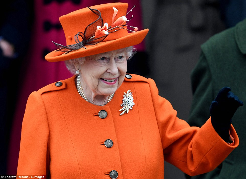 The Queen arrived at the service later by car wearing a bright orange jacket with an intricate floral hat Photo (C) GETTY