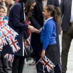 Meghan Markle Breaks Royal Protocol to Hug a Young Schoolgirl in Birmingham Photo (C) GETTY