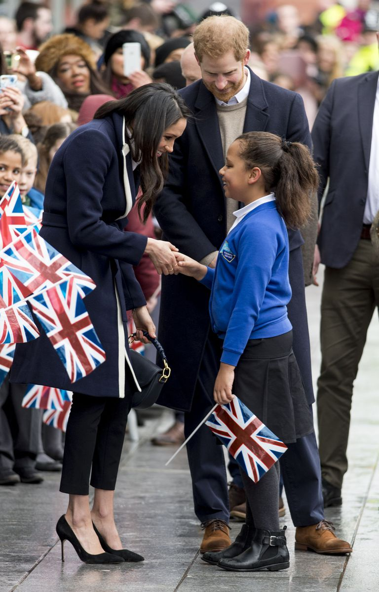 4 Meghan Markle Breaks Royal Protocol to Hug a Young Schoolgirl in Birmingham Photo C GETTY