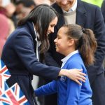 3 Meghan Markle Breaks Royal Protocol to Hug a Young Schoolgirl in Birmingham Photo C GETTY
