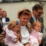 Fergie pictured with her daughters has been through a series of terrible scandals since joining 1986 Photo (C) PA