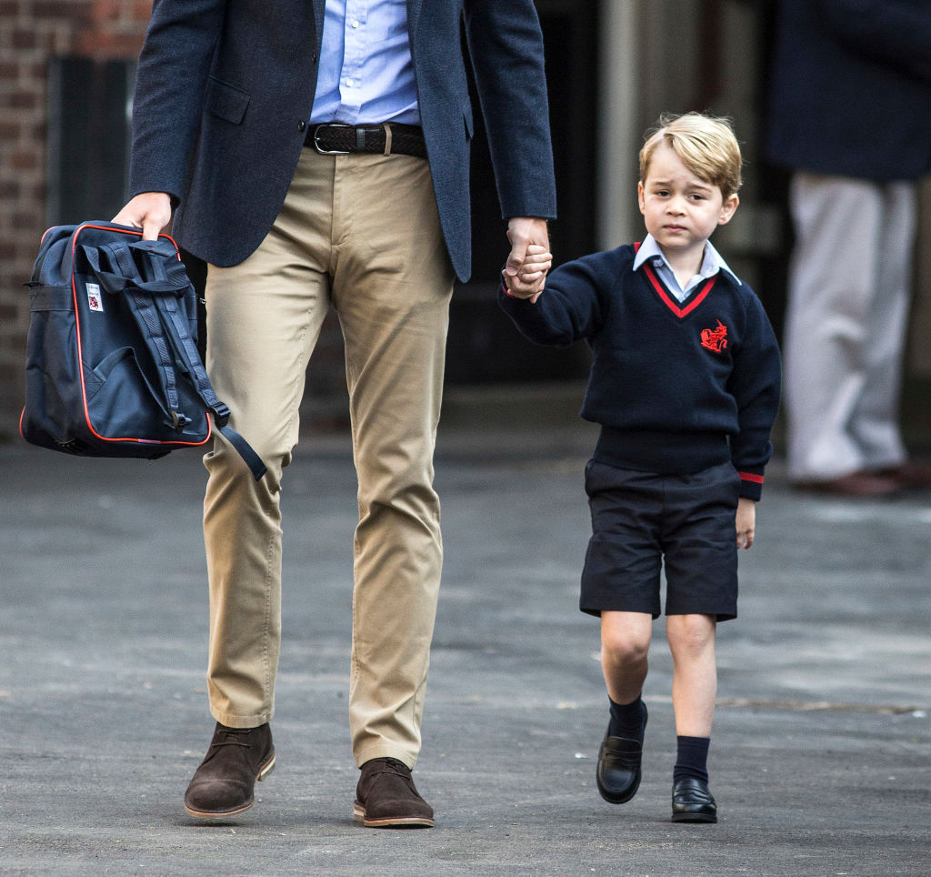 Prince George of Cambridge arrives for his first day of school with his father Prince William, Duke of Cambridge at Thomas