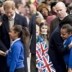 Meghan Markle Breaks Royal Protocol to Hug a Young Schoolgirl in Birmingham Photo C GETTY