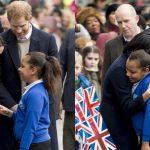 Meghan Markle Breaks Royal Protocol to Hug a Young Schoolgirl in Birmingham Photo C GETTY