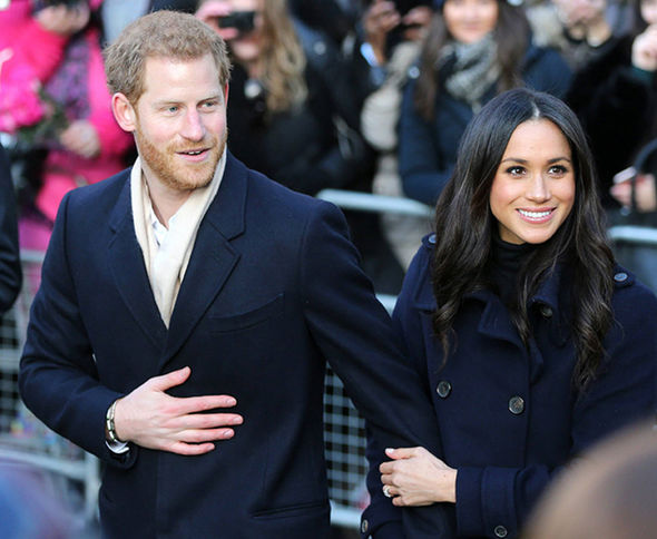 Meghan Markle and Prince Harry often put on displays of public affection Photo (C) EPA
