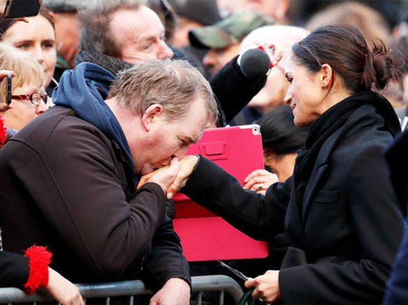 Meghan Markle broke royal rules when she let a member of the public kiss her hand Photo (C) GETTY