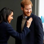 Meghan Markle waves to local school children during a walkabout with Britain's Prince Harry during a visit to Birmingham Photo (C) REUTERS