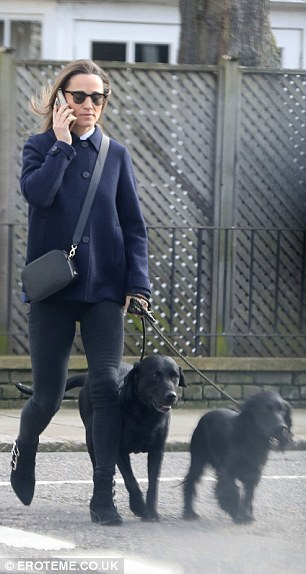 Mutt be love The younger sister of the Duchess of Cambridge, 34, braved the cold with Cocker Spaniel Rafa and her husband's black Labrador