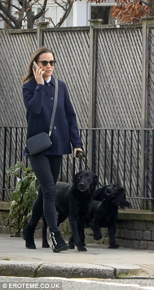 Mutt be love The younger sister of the Duchess of Cambridge, 34, braved the cold with Cocker Spaniel Rafa and her husband's black LabradorMutt be love
