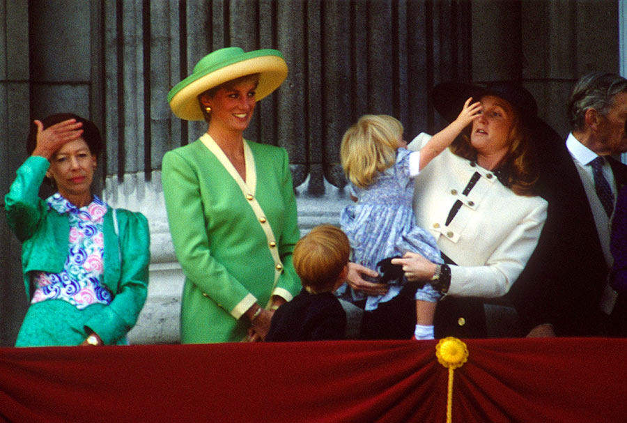 Naughty Princess Beatrice just wanted to try on her mum's hat during a balcony appearance! Sarah Ferguson Photo (C) REX