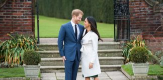 Prince Harry and Meghan Markle After Engagement Standing in Kensington Palace Garden Photo C GETTY 1