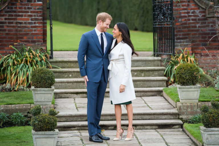 Prince Harry and Meghan Markle After Engagement Standing in Kensington Palace Garden Photo (C) GETTY