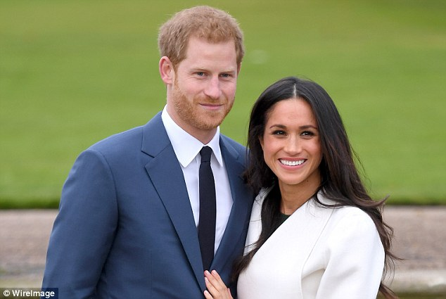 Prince Harry and Meghan Markle attend an official photocall to announce their engagement at The Sunken Gardens at Kensington Palace on November 27