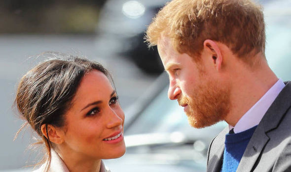 Prince Harry and Meghan Markle looked very much in love during their surprise visit to Belfast Photo (C) WENN