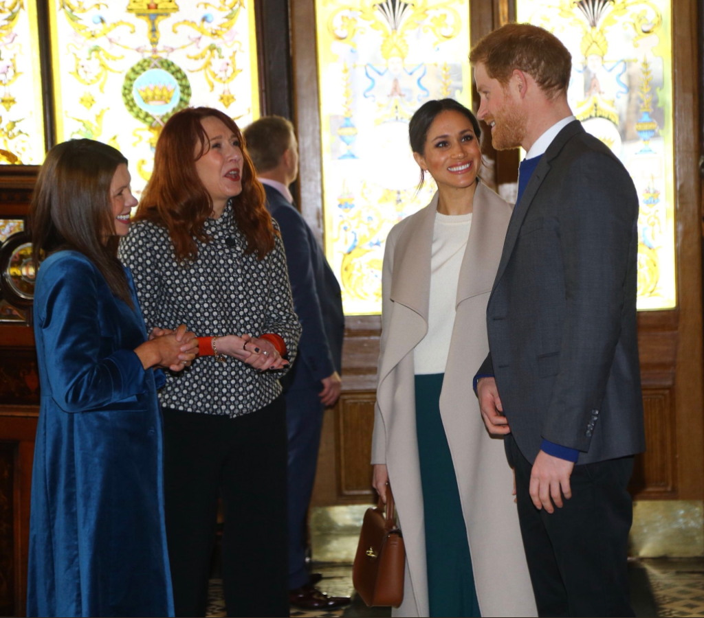 Prince Harry and Ms. Markle then visit one of Belfast's oldest buildings, The Crown Liquor Saloon and learn about its history from NationalTrust staff.Photo (C) TWITTER