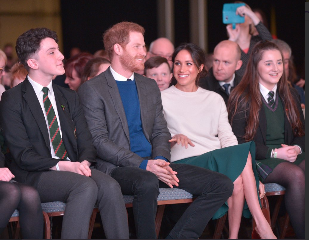 Prince Harry and Ms. Markle watch performances by local schools to celebrate how the Arts can unite different communities Photo (C) TWITTER KENSINGTON