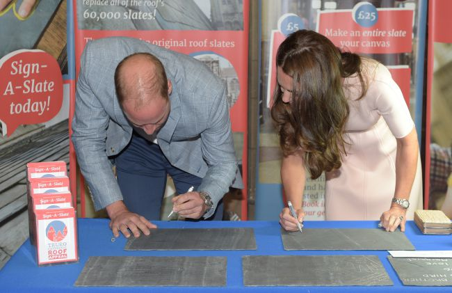 "The Duke and Duchess of Cambridge taking part in the ""sign-a-slate"" project in support of the place of worship's roof appeal as they visit Truro Cathedral at the start of a day-long tour of Cornwall. PRESS ASSOCIATION Photo. Picture date: Thursday September 1, 2016. See PA story ROYAL Cambridges. Photo credit should read: Ben Birchall/PA Wire"
