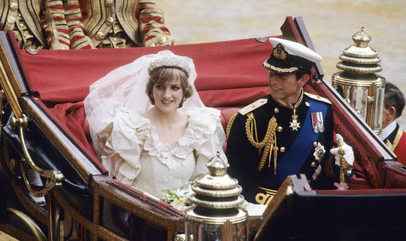 Princess Diana and Prince Charles ride in a carriage after their wedding Photo (C) GETTY