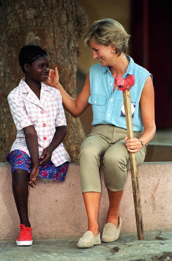 Royal wedding Princess Diana touches the cheek of Angola landmine victim Sandra Thijika Photo (C) GETTY