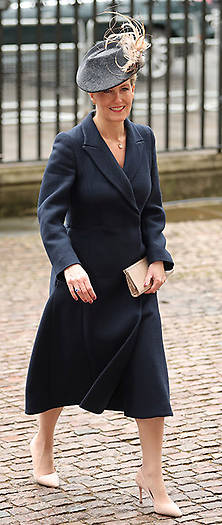 The Countess of Wessex also opted for a chic blue coat, which was styled with a coordinating hat and nude heels. Photo (C) GETTY
