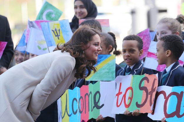 The Duchess of Cambridge bent down to chat to children [Wenn]