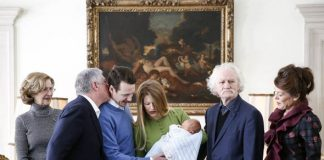 The Serbian Royals look delighted at the newest edition to their family Photo (C) GETTY
