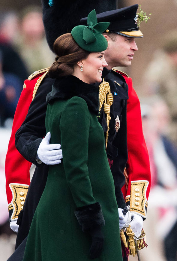 William placed a loving hand on his wife's back Photo (C) WIREIMAGE