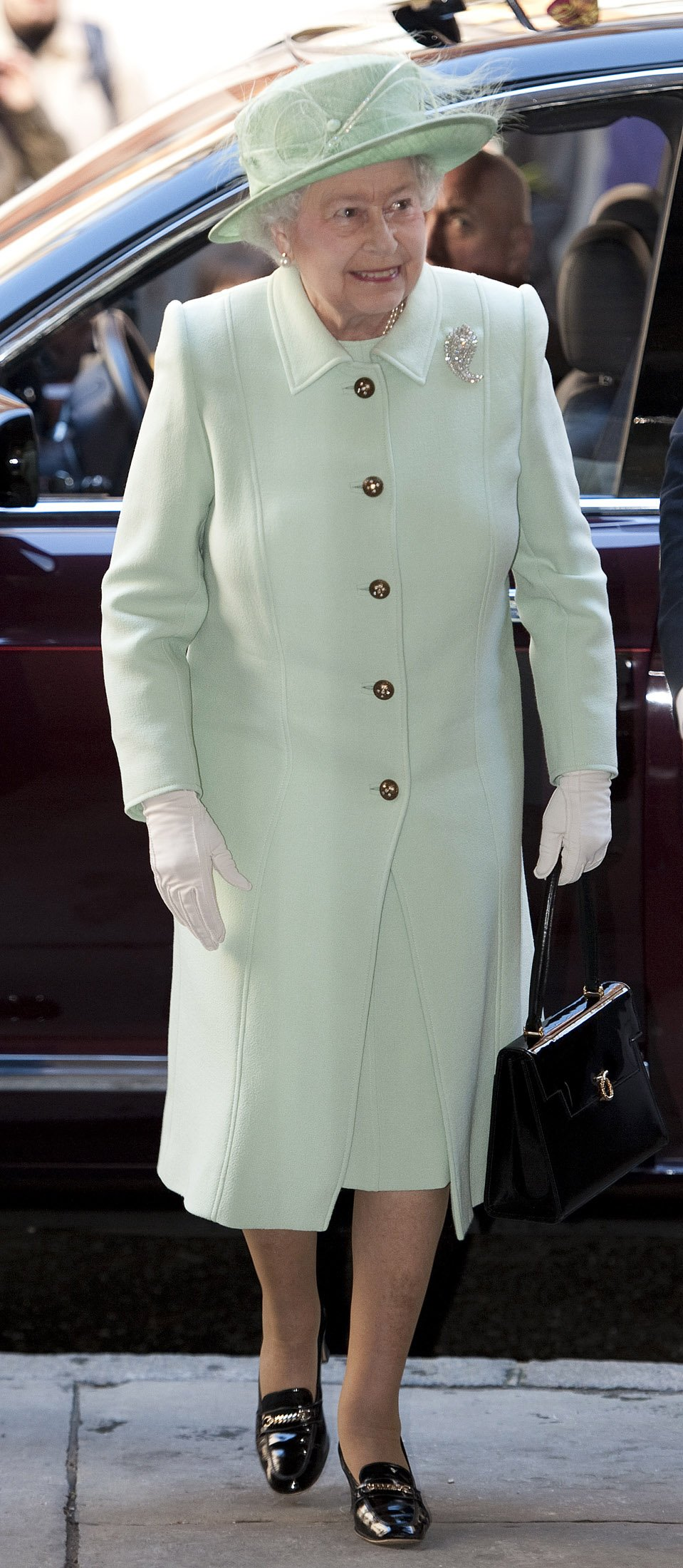 Queen Elizabeth II attends the unveiling of the Diamond Jubilee Stained Glass Window at The Queen
