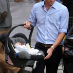 Prince William carrying Prince George home from hospital Photo (C) GETTY