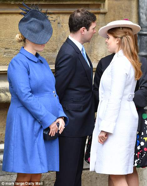 And Zara's blooming too! The 36-year-old, who attended without husband Mike and daughter Mia Rose, wore a bright blue coat with her own bump clearly visible as she chats to Princess Beatrice
