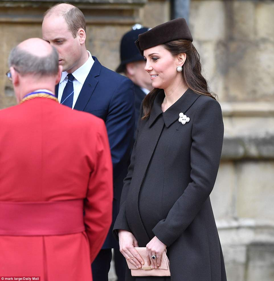 Bump's the word! Kate, 36, looked comfortable on a cold day dressed in a smart chocolate-brown coat with matching velour pillbox hat and caramel-coloured heels