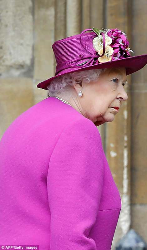 Cerise-ster! At the oth,er end of the colour spectrum, the Queen dazzled on a dreary morning in a bright pink outfit