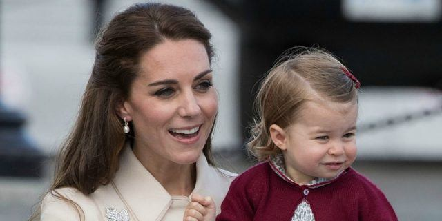 Duchess Kate Middleton holding Princess Charlotte.