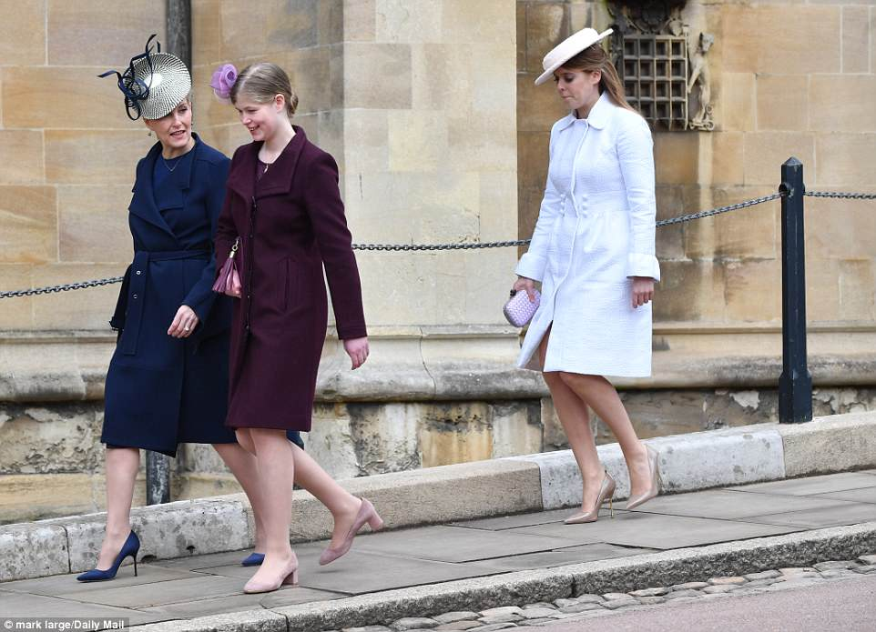 Lady Louise Windsor and Sophie Wessex stroll down the hill to the chapel, followed closely by Princess Beatrice, dressed all in white