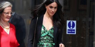 Meghan Markle Her choice of bare legs is believed to have been against the Queen's royal protocol Photo (C) GETTY