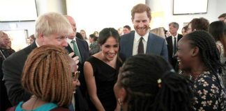 Meghan Markle and Prince Harry chatted with representatives from charities Photo (C) GETTY