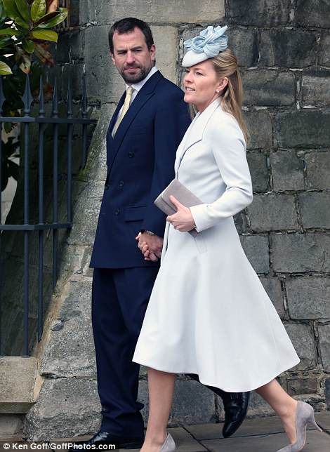 Peter Phillips arrived with wife Autumn, looking elegant in a co-ordinated grey dress-coat and hat by Suzannah Hunter