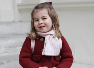 Princess Charlotte sitting on a staircase. Photo (C) KENSINGTON PALACE TWITTER