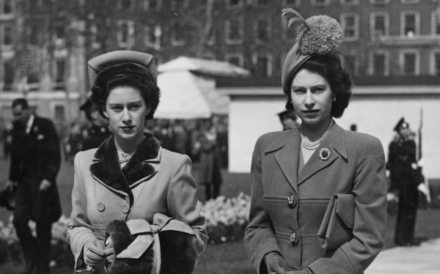 Princess Margaret and Queen Elizabeth walking together.