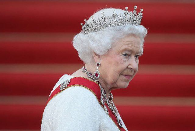 Queen Elizabeth II in a sash and tiara.
