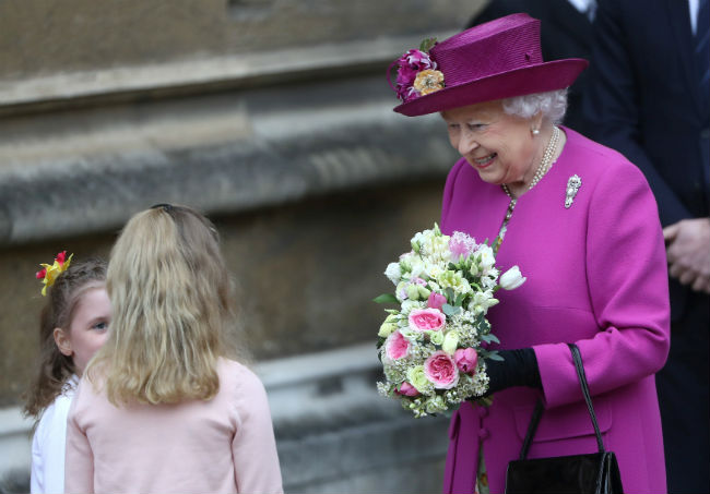 The Queen most recently recieved flowers at the Easter Sunday church service in Windsor Photo C GETTY