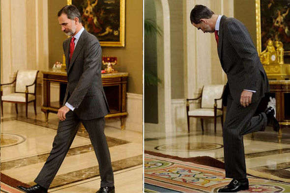 The Spanish royal, 50, narrowly avoided falling flat on his face Photo (C) GETTY