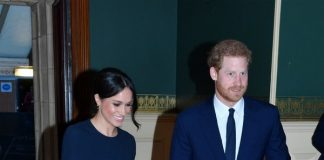To celebrate the Queen's 92nd birthday, Meghan Markle stepped out in a navy blue cape dress to match fellow royal family members