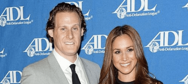 Trevor Engelson and Meghan Markle on a red carpet. Photo (C) GETTY