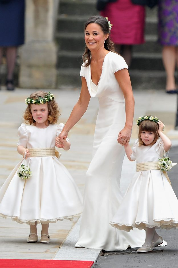 LONDON, ENGLAND - APRIL 29: Sister of the bride and Maid of Honour Pippa Middleton holds hands with Grace Van Cutsem and Eliza Lopes as they arrive t