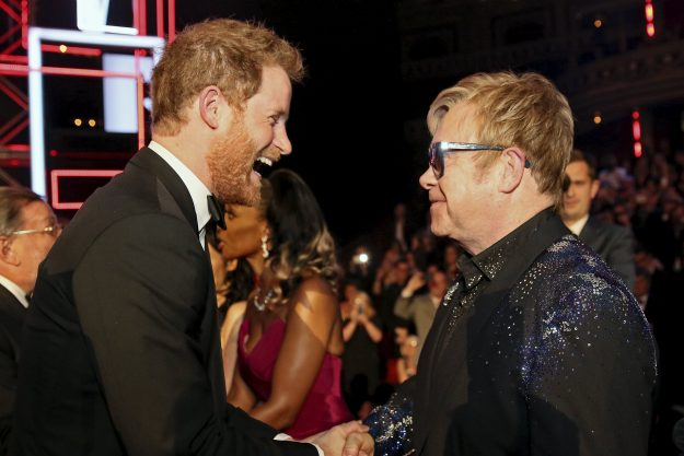 Britain's Prince Harry greets Elton John after the Royal Variety Performance. Sir Elton John will sing at his wedding [Getty]