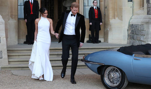 Meghan Markle and Prince Harry sped off to Frogmore House in a Jaguar Photo (C) PA